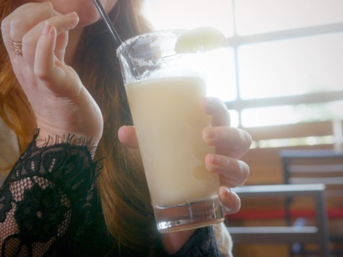 Woman drinking a margarita