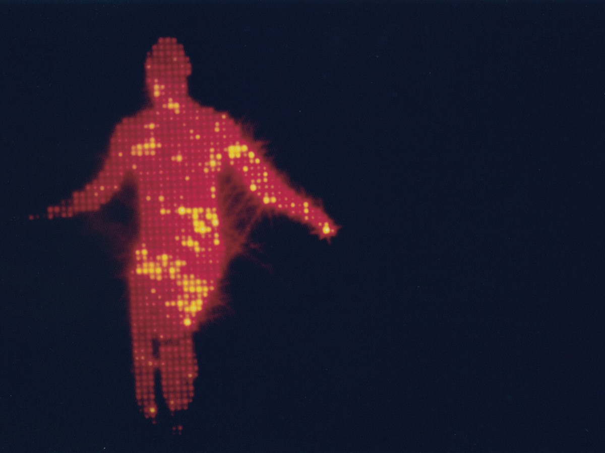Jack Goldstein, The Jump, 1978 (film still). 16 mm film, color, silent projection, and two black light tubes; 26 seconds