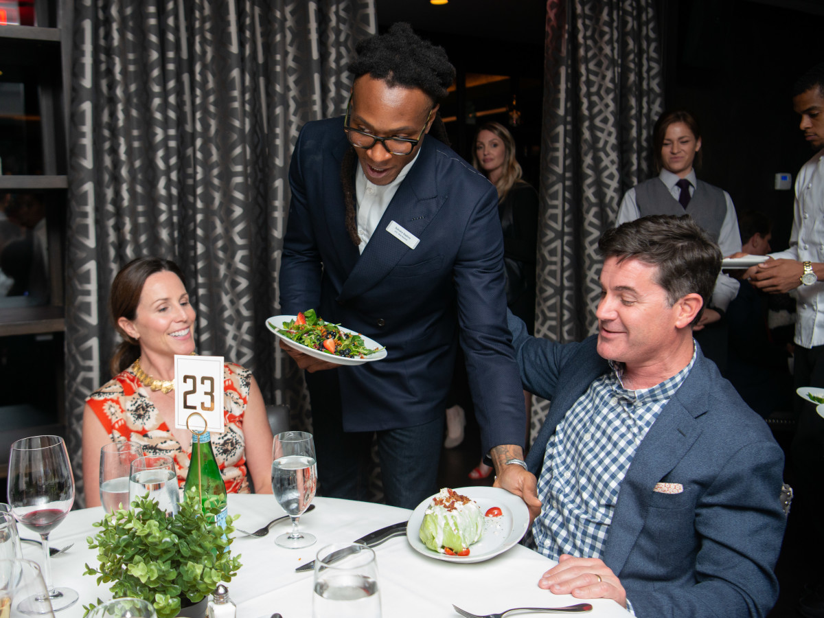 Houston Texans Champions for Youth Dinner DeAndre Hopkins serving