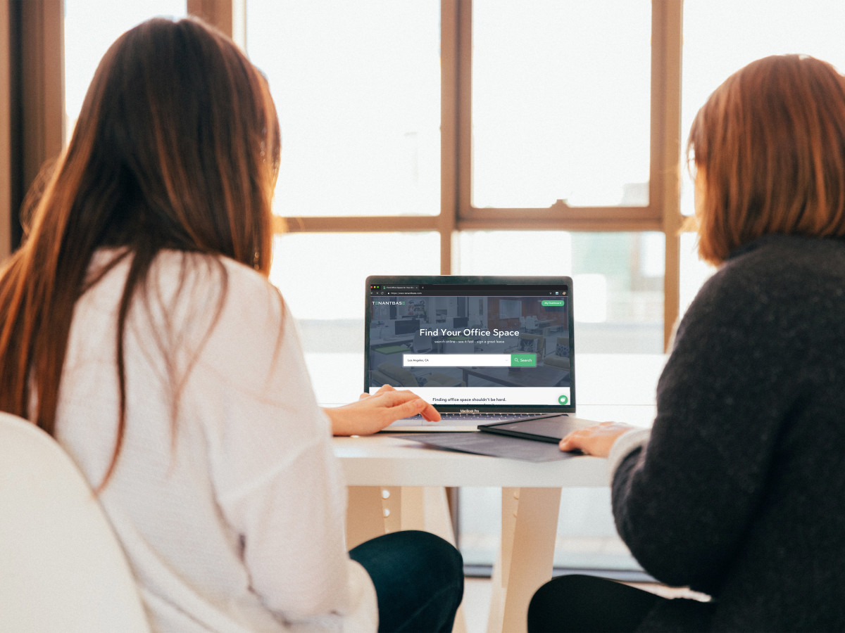 Two women looking at TenantBase on laptop