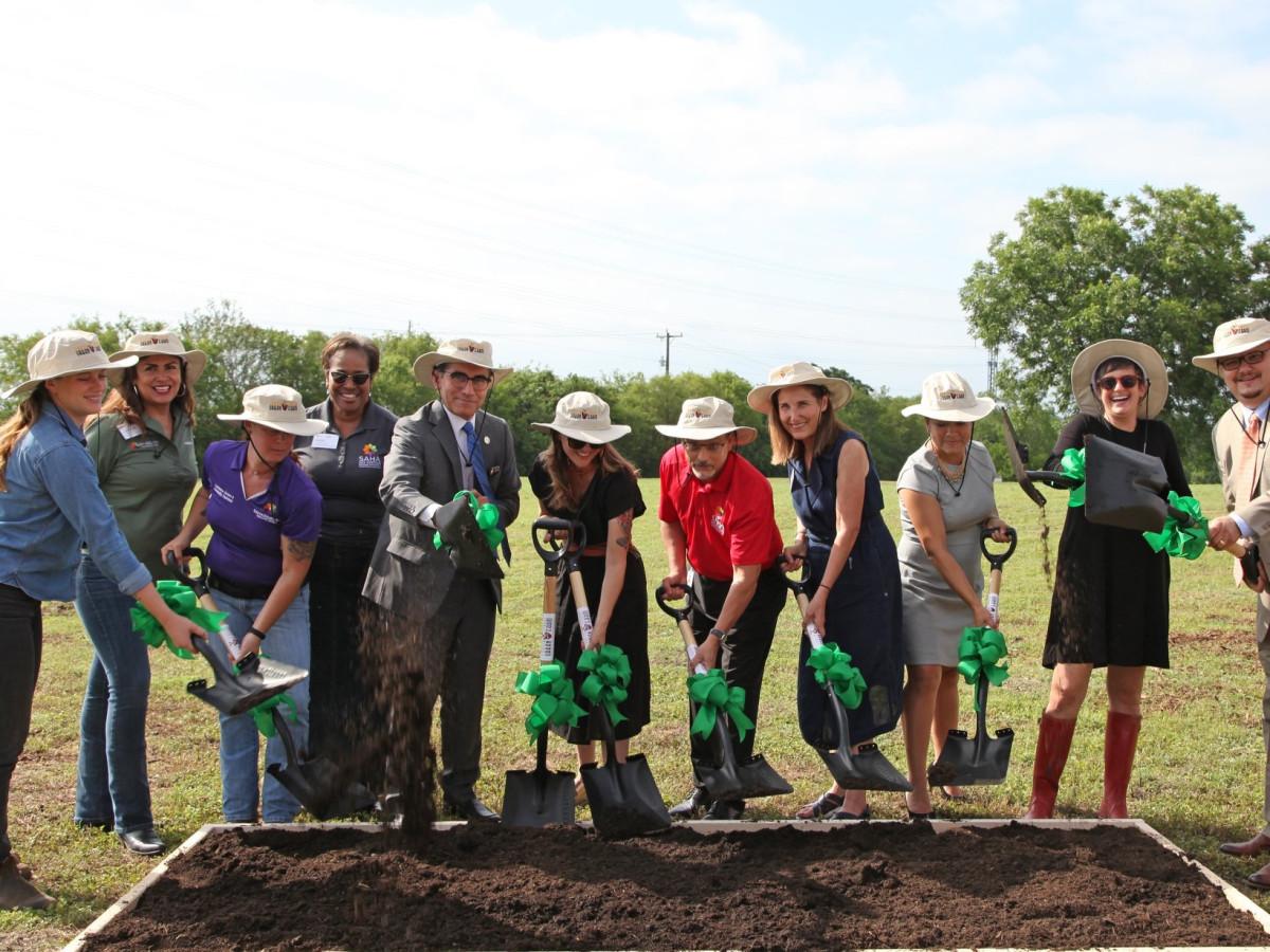 Project partners break ground on the Garcia Street Urban Farm.