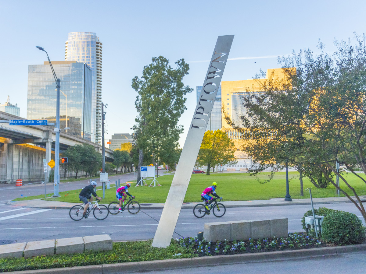 Bicyclists riding through Uptown Dallas