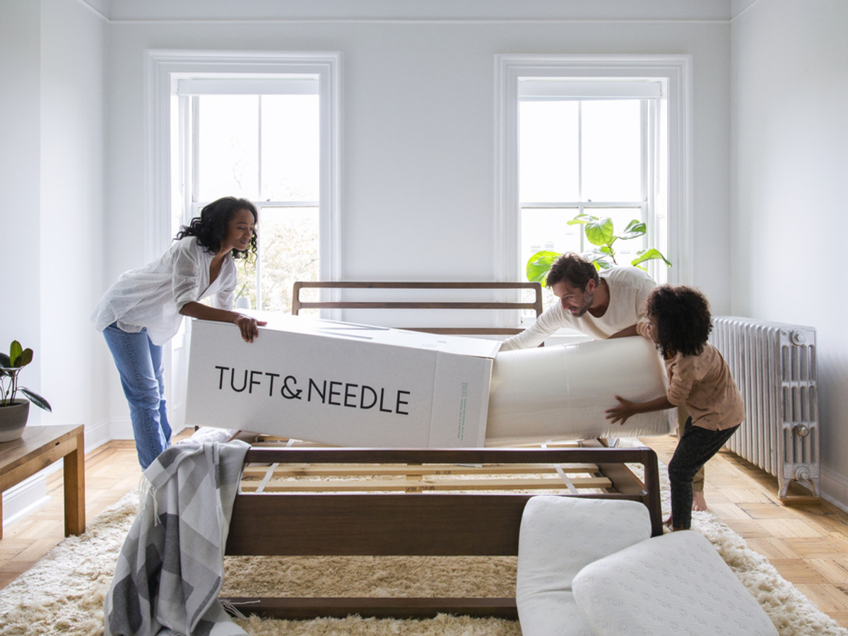 Family unrolling Tuft & Needle mattress