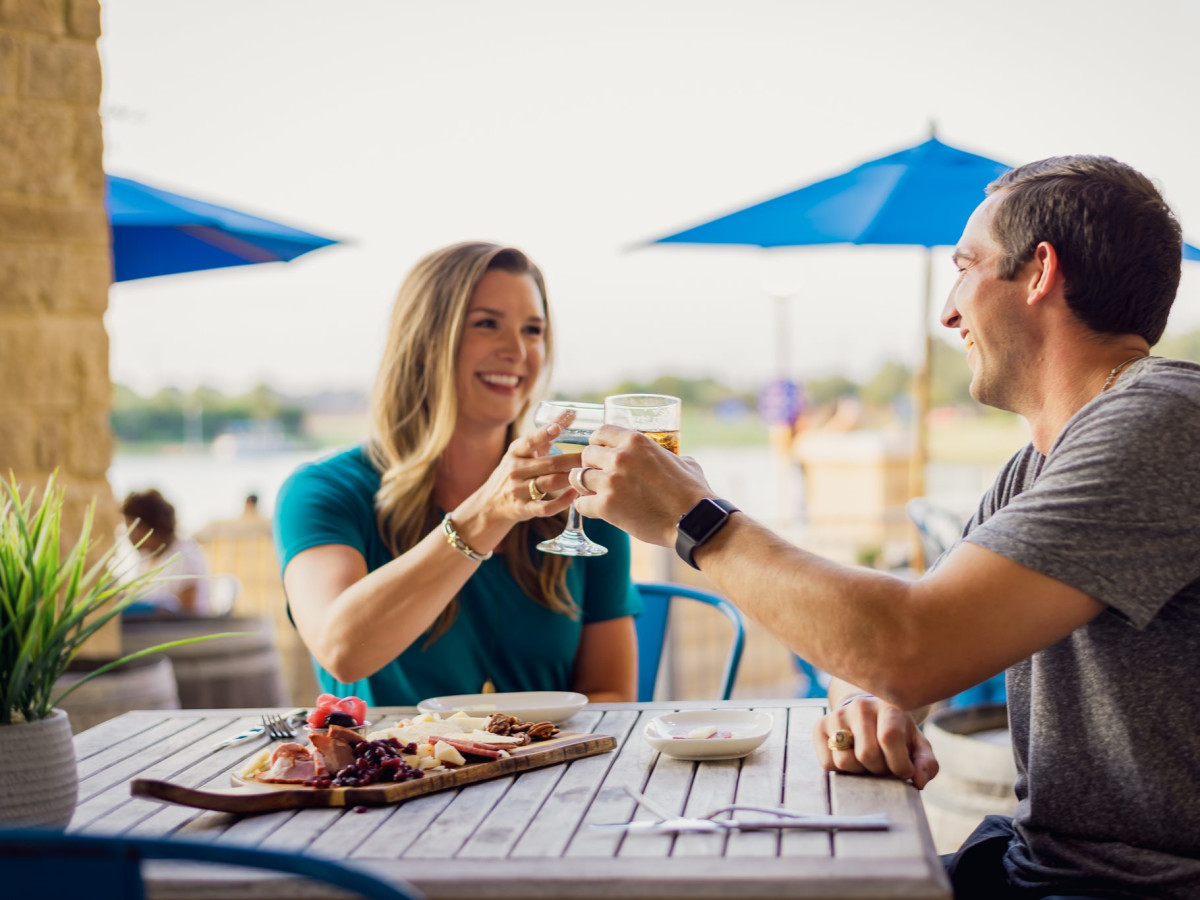 Couple dining at Flying Vine at The Boardwalk at Towne Lake