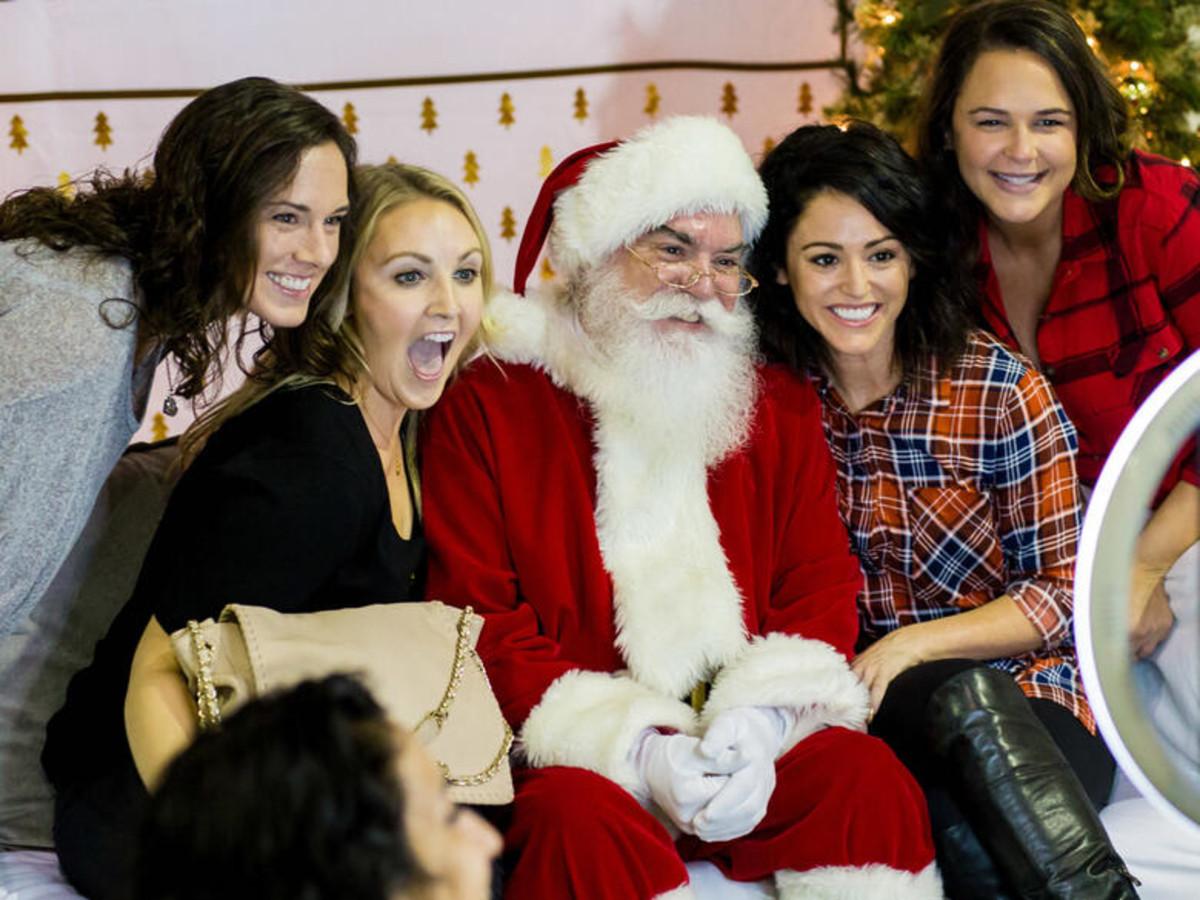Santa and girls at a photo booth