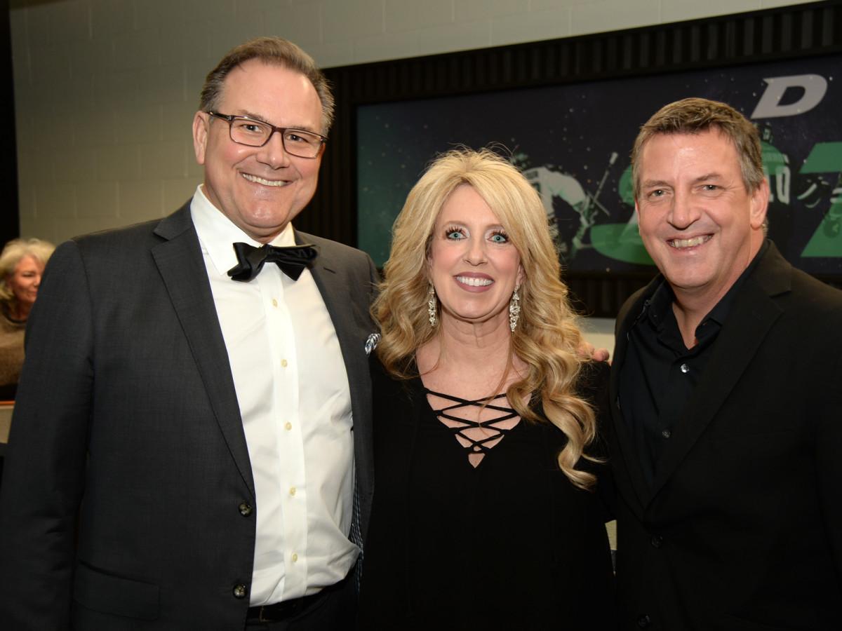 "Dallas Stars broadcaster Daryl ""Razor"" Reaugh with Terina Peabody and Dan Peabody"