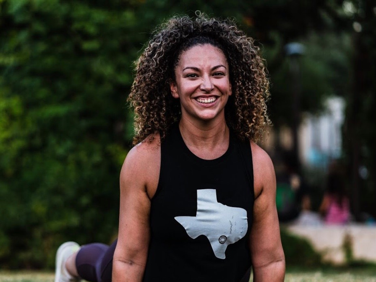 Woman smiling while doing yoga