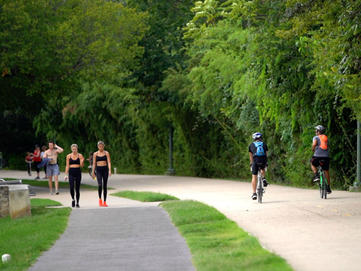 Riding bikes jogging Katy Trail