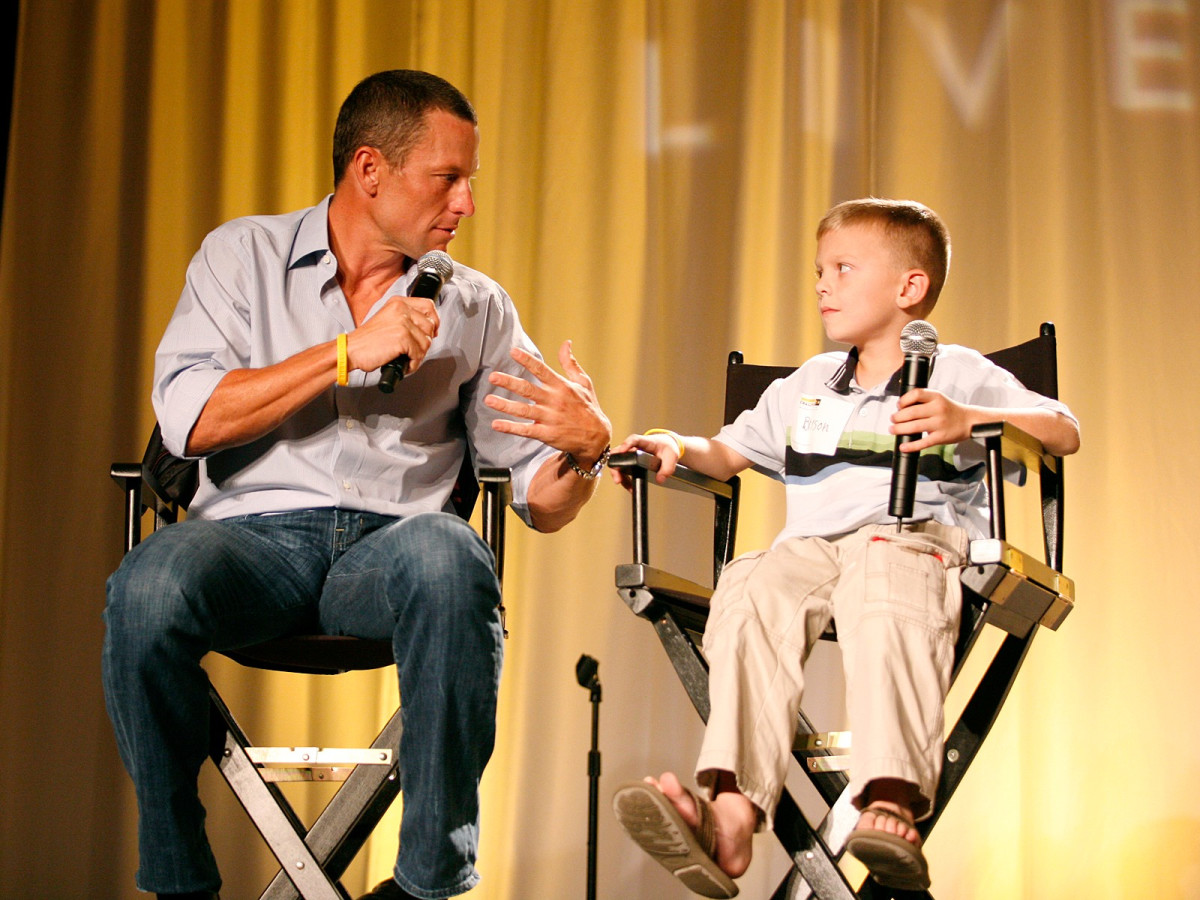 Lance Armstrong and unnamed child at Livestrong event