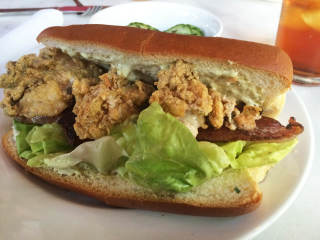 The Honeymoon restaurant interior with crowd fried oyster sandwich with bacon and lettuce September 2014