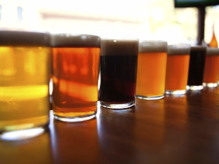 Craft beers along a bar