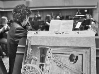 sheet music on music stand in an orchestra
