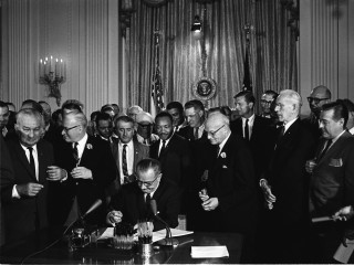 Lyndon B. Johnson LBJ signing Civil Rights Act of 1964 with Martin Luther King Jr. MLK