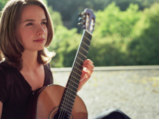 classical guitarist Janet Grohovac with guitar