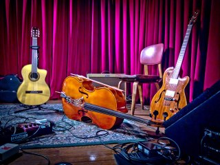 instruments on the stage of the Cactus Cafe