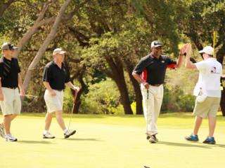 golfers playing in CASA Kids Golf Classic