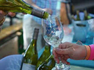 White wine glass pouring