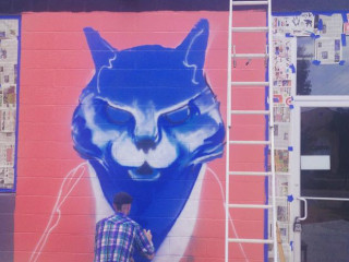Blue Cat Cafe Austin exterior mural in process 2015