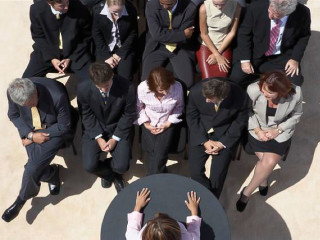Business men and women at a seminar