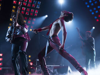 Gwilym Lee (Brian May), Rami Malek (Freddie Mercury), and Joe Mazzello (John Deacon) star in Twentieth Century Fox's BOHEMIAN RHAPSODY.] Gwilym Lee, Rami Malek, and Joe Mazzello in Bohemian Rhapsody
