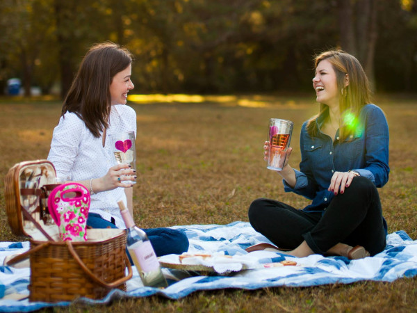 Ladies picnicking with Tervis tumblers