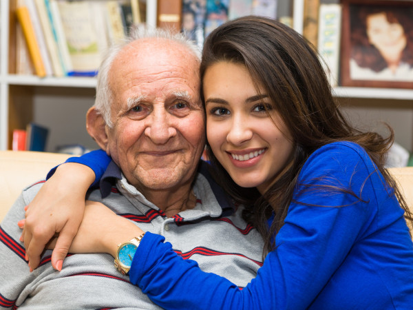 Elderly man with younger woman