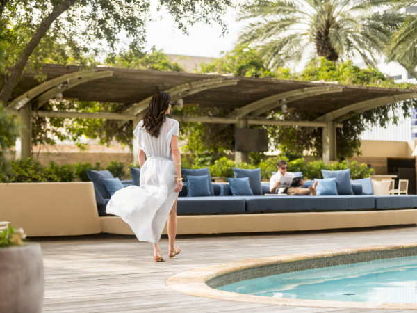Four Seasons Houston pool woman walking spa