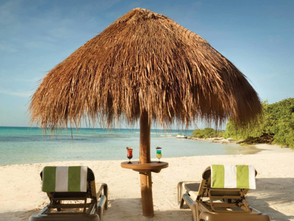 Hyatt Ziva Cancun beach chairs tropical drinks vacation