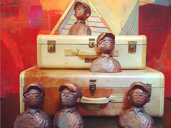 Busts and vintage suitcases at Life of Riley in Deep Ellum