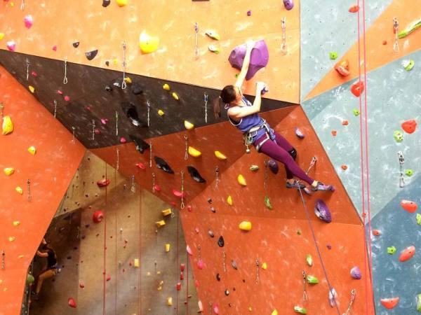 InspireRock climbing gym person climbing