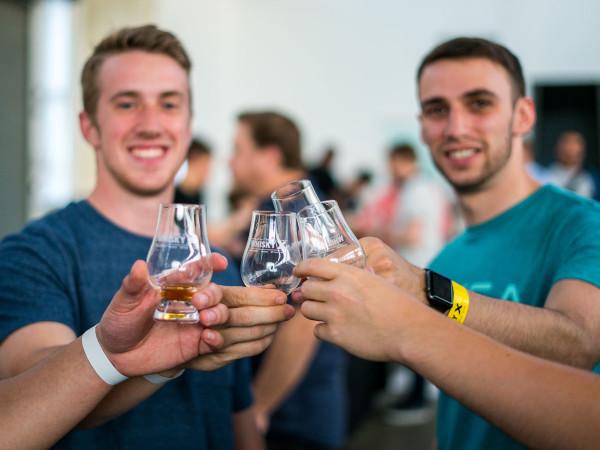 Men toasting with bourbon