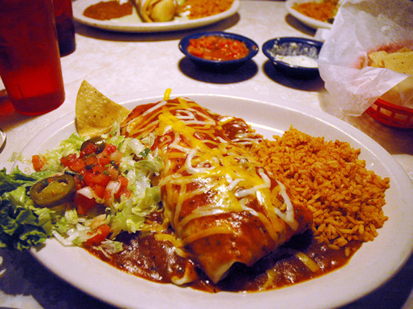 Chuy's giant burrito with cheese on top