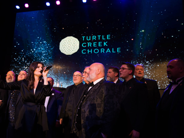 "Idina sings ""Seasons of Love"" and ""No Day But Today"" with the Turtle Creek Chorale."