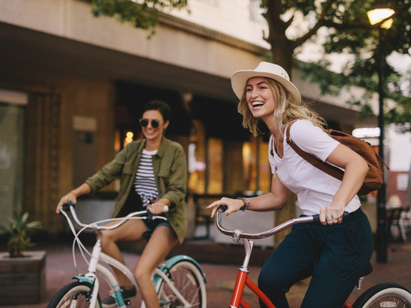 Two girls riding bikes