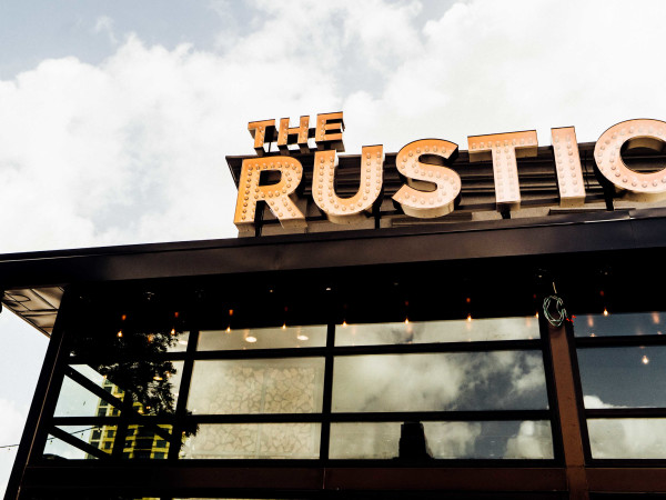 The Rustic Post Oak sign