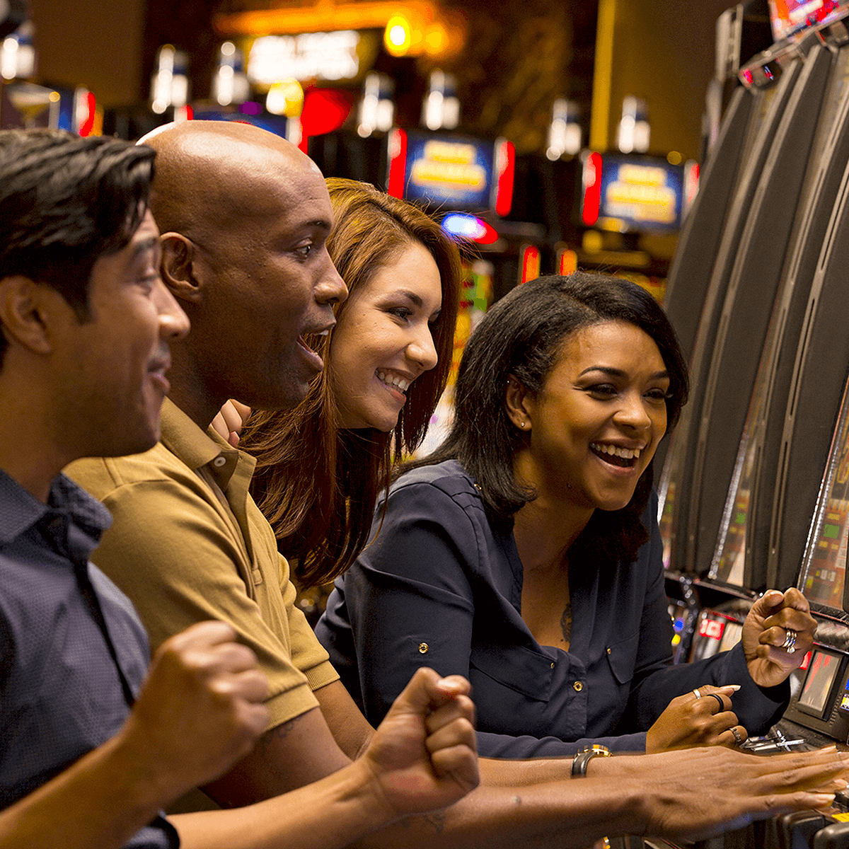 People playing slot machines