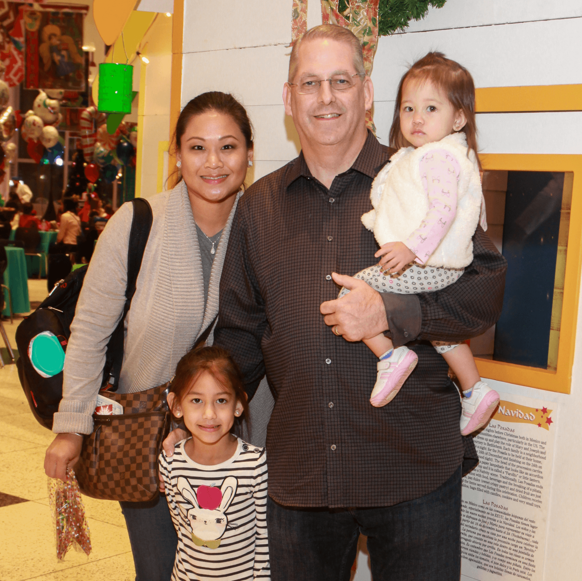 Children's Museum holiday party, Linda Dang, Tom Debesse and childre