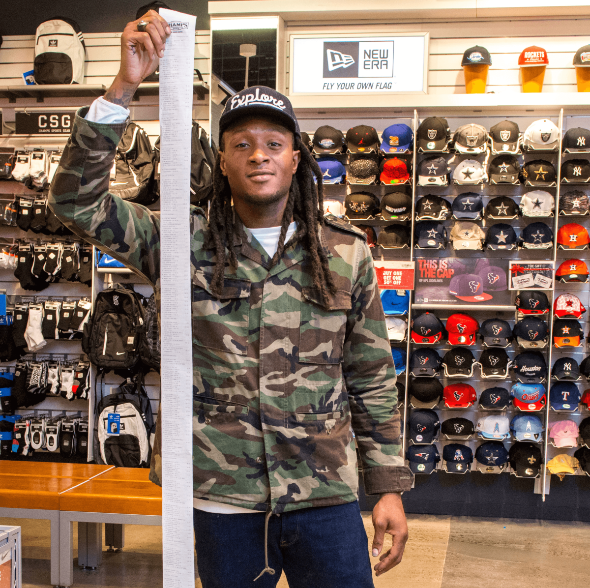 DeAndre Hopkins with bill from shopping spree for kids