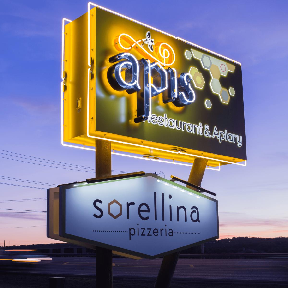 Apis Restaurant and Apiary Pizzeria Sorellina sign
