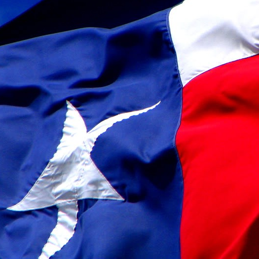 Texas flag flying closeup