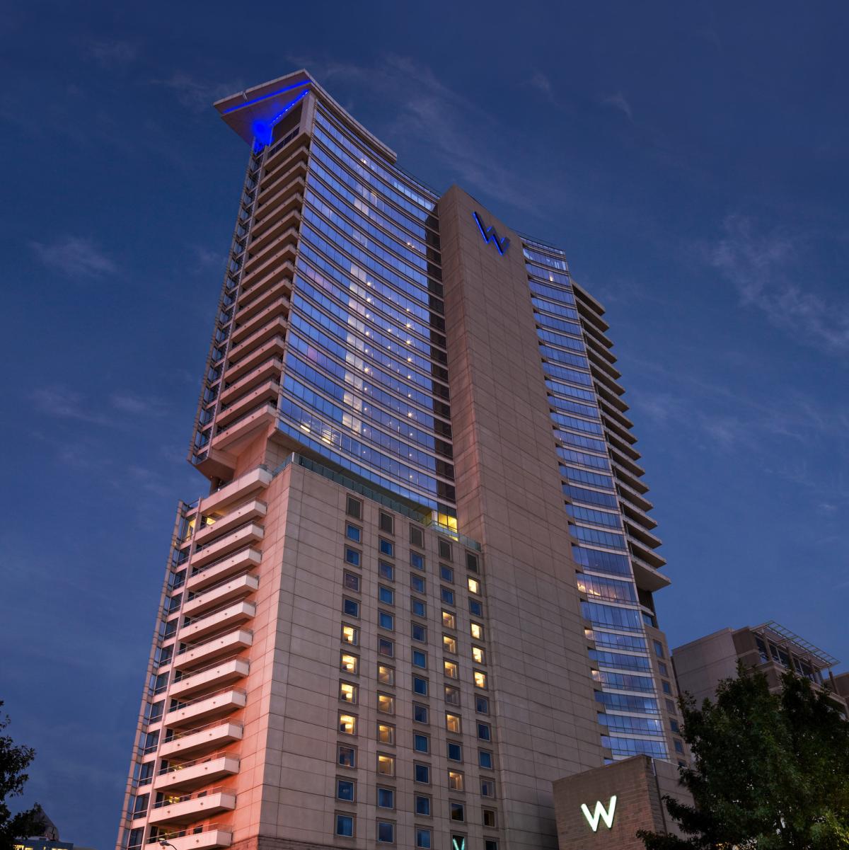 w dallas, victory exterior hotel at night