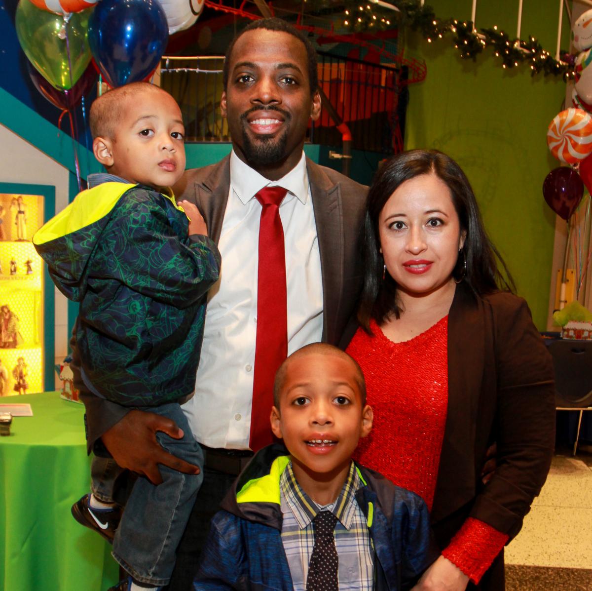 Children's Museum holiday party, Hakim Johnson, Araceli Johnson and children