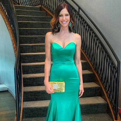 Model in Sherri Hill gown and Carlos Falchi clutch at Elizabeth Anthony