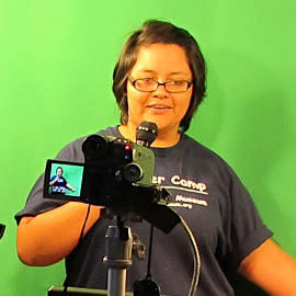 News_Katie_Weather Museum_Weather Museum Coordinator, Eliana Perez_giving a forecast_in the Green Screen Room