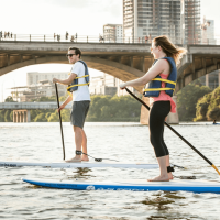 Austin Congress Avenue Bridge paddle board Lady Bird Lake Town Colorado River