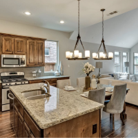 open concept kitchen with granite countertops & home interior