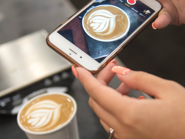 Taking a photo of a latte
