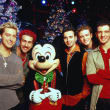 Christmas photo of N Sync with Mickey Mouse for Action Pack Xmas Pops sing along cropped