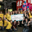 A 2nd Cup employees receive a $100,000 check from Reliant Gives