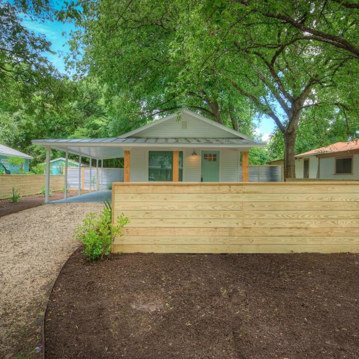 1122 Gunter St 78702 East Austin house front fence 2015